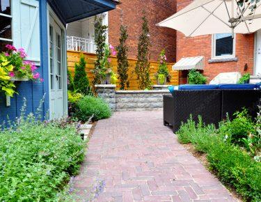 paved walkway urban garden with patio furniture