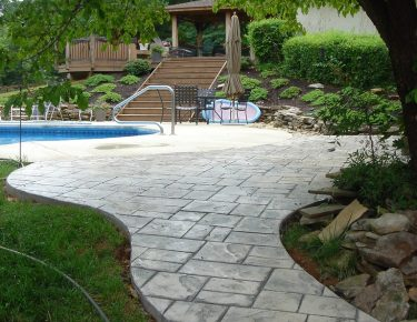 stamped concrete walkway to swimming pool